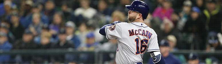 Apr 17, 2018; Seattle, WA, USA; Houston Astros catcher Brian McCann (16) hits a two-run homer against the Seattle Mariners during the sixth inning at Safeco Field. Mandatory Credit: Joe Nicholson-USA TODAY Sports