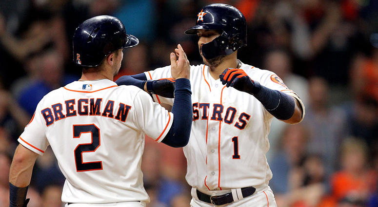 May 12, 2018; Houston, TX, USA; Houston Astros shortstop Carlos Correa (1) celebrates with third baseman Alex Bregman (2) after hitting a two run home run against the Texas Rangers during the eighth inning at Minute Maid Park. Mandatory Credit: Erik Willi