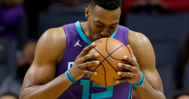 Hornets agree to trade Howard to Nets for Mozgov