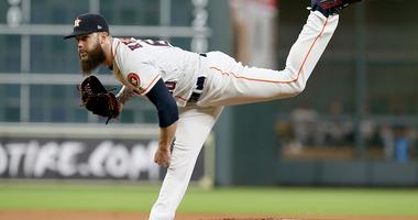 Dallas Keuchel follows through against the Mariners