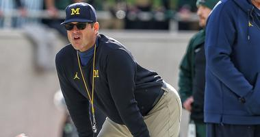Michigan 7th grader has offer from Harbaugh, father says
