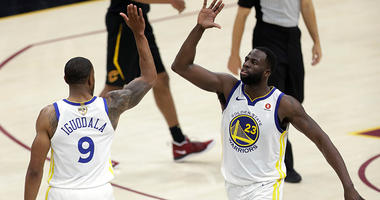Golden State Warriors' Andre Iguodala and Draymond Green celebrate during the second half of Game 3 of basketball's NBA Finals against the Cleveland Cavaliers, Wednesday, June 6, 2018, in Cleveland. The Warriors defeated the Cavaliers 110-102 to take a 3-