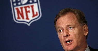 NFL commissioner Roger Goodell tells reporters the NFL team owners have reached agreement on a new league policy that requires players to stand for the national anthem or remain in the locker room during the NFL owner's spring meeting Wednesday, May 23, 2