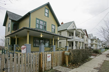 """FILE - This Dec. 15, 2008, file photo shows the house, left, where the 1983 movie """"A Christmas Story"""" was filmed in Tremont neighborhood of Cleveland. The Cleveland house known for its appearance in the holiday classic """"A Christmas Story"""" is planning to e"""