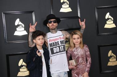 Travis Barker, center, arrives at the 59th Annual Grammy Awards