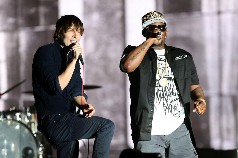 INDIO, CA - APRIL 13: Rapper R. Kelly (R) performs with musician Thomas Mars (L) of Phoenix onstage during day 2 of the 2013 Coachella Valley Music & Arts Festival at the Empire Polo Club on April 13, 2013 in Indio, California. (Photo by Christopher Polk/