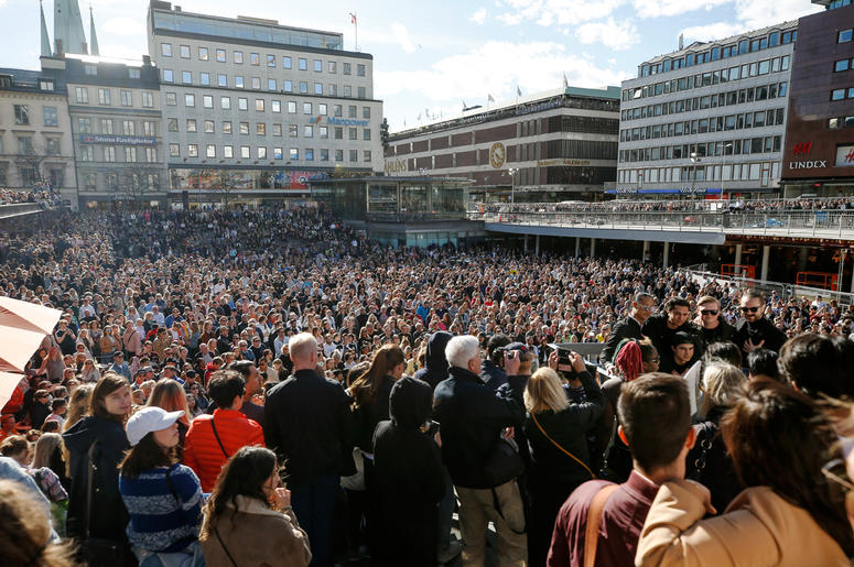 Fans of DJ Avicii gather for a minute's silence in his honour following the news of his death, at Sergels Torg in central Stockholm, Sweden, Saturday, April 21, 2018.