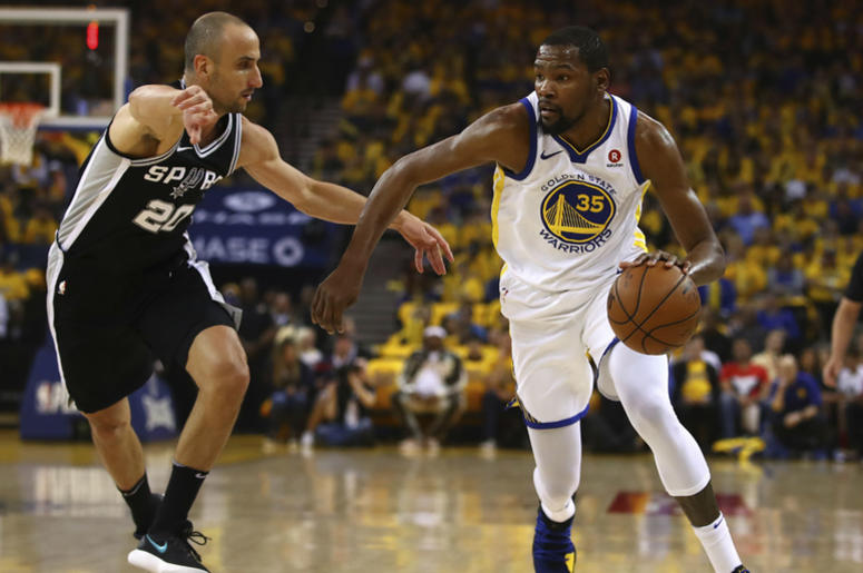 Golden State Warriors' Kevin Durant, right, drives the ball against San Antonio Spurs' Manu Ginobili