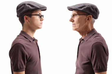 Young Man Looking At Older Version Of Himself