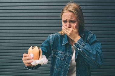 Woman disgusted at her burger.