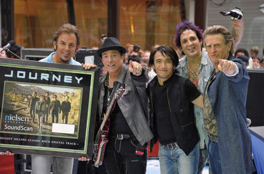 NEW YORK, NY - JULY 29: (L-R) keyboard player Jonathan Cain, guitar player Neal Schon, singer Arnel Pineda, drummer Deen Castronovo, and bass player Ross Valory of the band Journey performs\ at the 2011 Today Summer Concert series at Rockefeller Plaza on