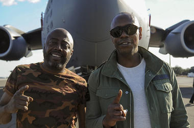 Dave Chappelle (right) and Donnell Rawlings, actors and comedians, stand in front of a C-17 Globemaster III Feb. 2, 2017, at Joint Base Charleston, S.C. Chappelle was in town for his stand-up comedy show when he made the visit to see service members and f