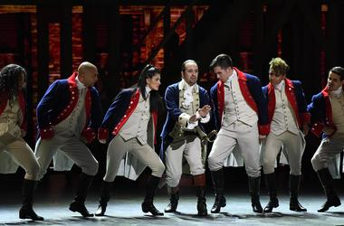 June 12, 2016; New York, NY, USA; Lin-Manuel Miranda (center) and the cast of 'Hamilton' perform during the 70th Tony Awards at the Beacon Theatre. Mandatory Credit: Robert Deutsch-USA TODAY NETWORK