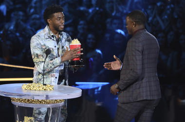 "Chadwick Boseman, left, gives his best hero award for his role in ""Black Panther"" to James Shaw Jr."