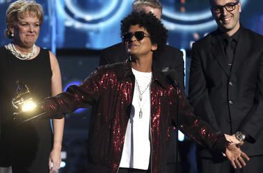 Bruno Mars accepts the award for record of the year