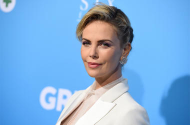 "In this March 6, 2018 file photo, Charlize Theron arrives at the Los Angeles premiere of ""Gringo"" at Regal L.A. Live. Theron was quoted in an Elle magazine interview published last week saying that she wouldn't travel to parts of the United States with he"
