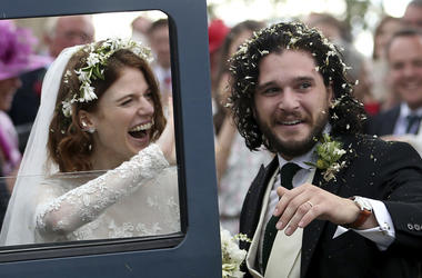"Actors Kit Harington and Rose Leslie react as they leave after their wedding ceremony, at Rayne Church, Kirkton of Rayne in Aberdeenshire, Scotland, Saturday June 23, 2018. Former ""Game of Thrones"" co-stars Kiet Harington and Rose Leslie married near the"