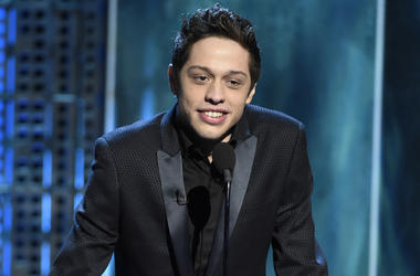 "In this March 14, 2015, file photo, Pete Davidson speaks at a Comedy Central Roast at Sony Pictures Studios in Culver City, Calif. Davidson says he's the ""luckiest guy in the world"" after wasting little time pursuing Ariana Grande. In the September 2018 G"