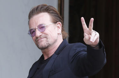 In this Monday, July 24, 2017 file photo, U2 singer Bono makes a peace sign as he arrives for a meeting at the Elysee Palace, in Paris, France. (AP Photo/Michel Euler, file)