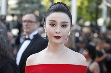 """In this May 24, 2017, file photo, Chinese actress Fan Bingbing poses for photographers as she arrives for the screening of the film The Beguiled at the 70th international film festival, Cannes, southern France. The director of the film """"Air Strike,"""" featu"""
