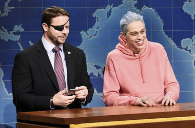 "In this Nov. 10, 2018 photo provided by NBC, Lt. Com. Dan Crenshaw, from left, a congressman-elect from Texas and Pete Davidson appear during Saturday Night Live's ""Weekend Update"" in New York. Davidson made his apologies to Crenshaw whose appearance he m"