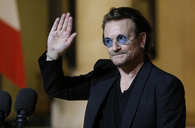 In this Monday, Sept. 10, 2018, file photo, U2 singer Bono waves goodbye to the media after a meeting with French President Emmanuel Macron at the Elysee Palace in Paris, France. Bono is scheduled to speak in Chicago, Thursday, Dec. 6, 2018, about his eff