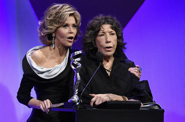 "In this Feb. 21, 2017 file photo, presenters Jane Fonda, left, and Lily Tomlin address the audience during the 19th Annual Costume Designers Guild Awards in Beverly Hills, Calif. As the fifth-season adventures of ""Grace and Frankie"" begin, viewers can res"