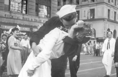 In this Aug. 14, 1945 file photo provided by the U.S. Navy, a sailor and a woman kiss in New York's Times Square, as people celebrate the end of World War II. The ecstatic sailor shown kissing a woman in Times Square celebrating the end of World War II ha