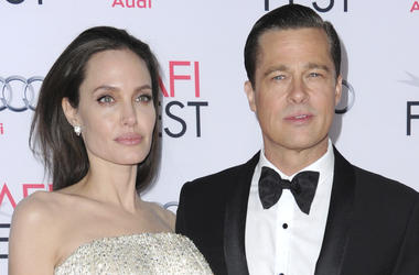 "In this Nov. 5, 2015 file photo, Angelina Jolie, left, and Brad Pitt arrive at the 2015 AFI Fest opening night premiere of ""By The Sea"" in Los Angeles. (Photo by Richard Shotwell/Invision/AP, File)"