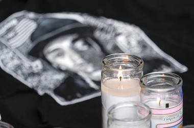 Candles appear at a makeshift memorial for rapper Nipsey Hussle