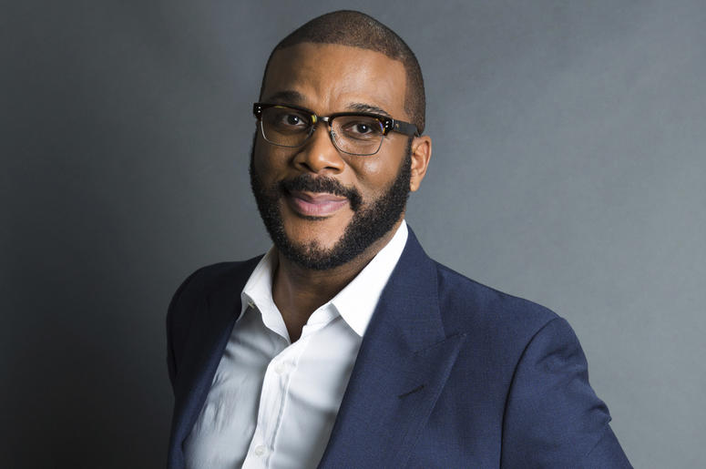 "In this Nov. 16, 2017, file photo, actor-filmmaker and author Tyler Perry poses for a portrait in New York to promote his book, ""Higher Is Waiting."" Perry is warning fans not to be scammed. The actor, comedian and director in a video says he's not giving"