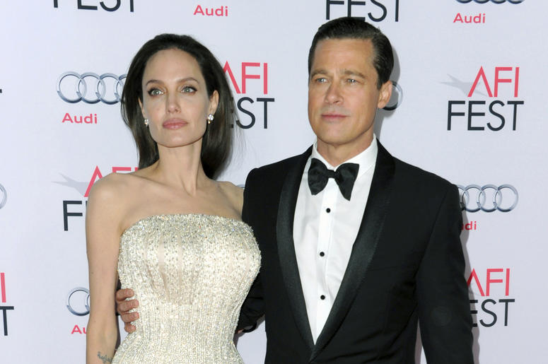 """In this Nov. 5, 2015 file photo, Angelina Jolie, left, and Brad Pitt arrive at the 2015 AFI Fest opening night premiere of """"By The Sea"""" in Los Angeles. Jolie Pitt says she wants her divorce from Brad Pitt finalized before the end of the year, and that she"""