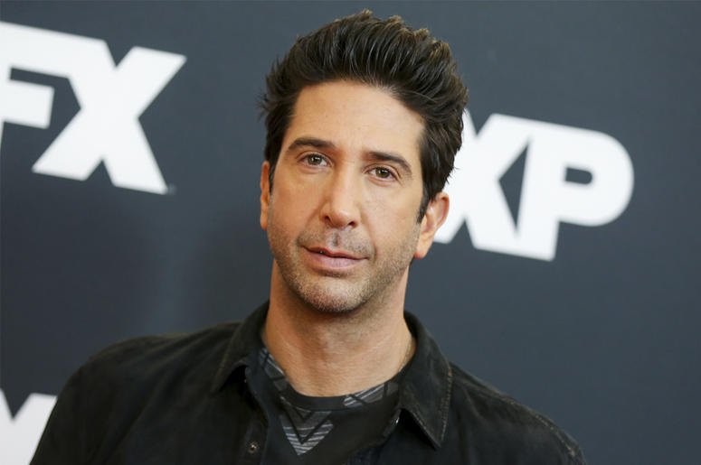 """In this Jan. 16, 2016 file photo, David Schwimmer arrives at the 2016 FX Winter TCA in Pasadena, Calif. NBC announced that Schwimmer will have a recurring role on """"Will & Grace"""" as Grace's new love interest. The program returns for a second season on Oct."""