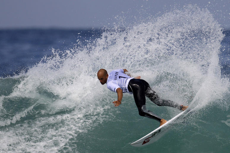 In this May 17, 2011, file photo, Kelly Slater competes in the first round of the Billabong Rio Pro surfing competition at the Arpoador Beach in Rio de Janeiro. (AP Photo/Felipe Dana, File)
