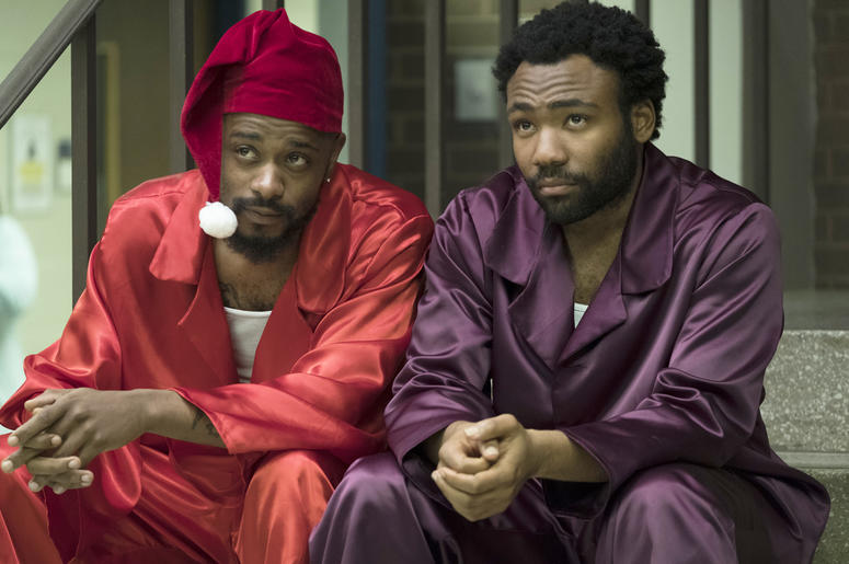 "This image released by FX shows Lakeith Stanfield, left, and Donald Glover in a scene from the comedy series ""Atlanta."" Glover was nominated Thursday for an Emmy for outstanding lead actor in a comedy series. The 70th Emmy Awards will be held on Monday, S"