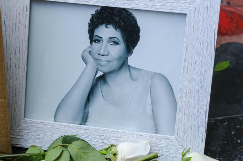 "People pay their respects with flowers and pictures on Aretha Franklin's star at the Hollywood Walk of Fame in Los Angeles.  Aretha Franklin, the ""Queen of Soul,"" died Thursday in her home city of Detroit after battling pancreatic cancer."
