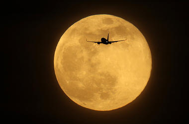 FEBRUARY 19: A plane flies in the sky in front of the largest Supermoon of 2019 on February 19, 2019 in London, England. Today's Supermoon, sometimes known as the Super Snow Moon is the second supermoon of the year. (Photo by Dan Kitwood/Getty Images)