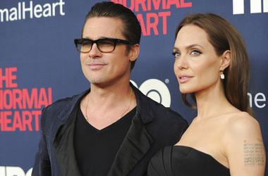 """Brad Pitt and Angelina Jolie attend the premiere of HBO Films' """"The Normal Heart"""" at the Ziegfeld Theatre in New York. Jolie and Pitt are officially single, though more work is left before the terms of their divorce are final. Los Angeles Superior Court d"""