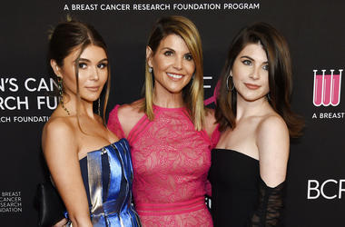 "In this Feb. 28, 2019 file photo, actress Lori Loughlin, center, poses with daughters Olivia Jade Giannulli, left, and Isabella Rose Giannulli at the 2019 ""An Unforgettable Evening"" in Beverly Hills, Calif. Loughlin and her husband Mossimo Giannulli were"