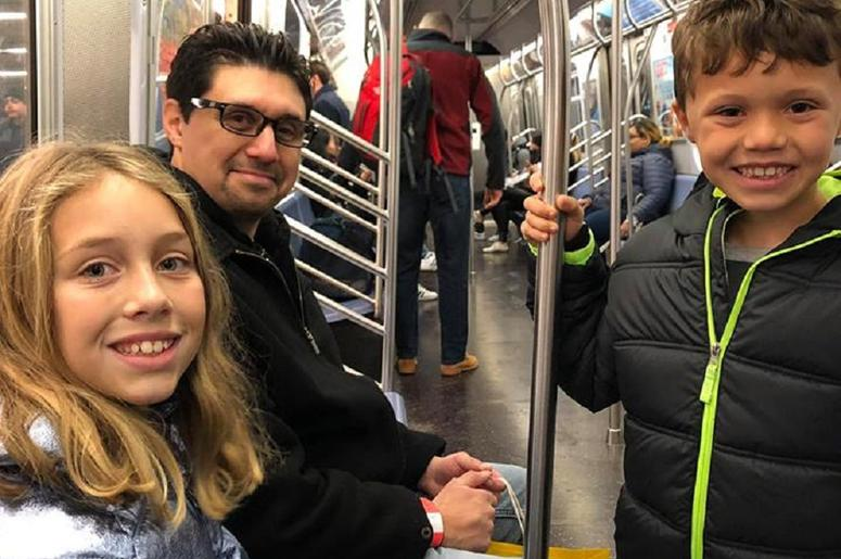 Riding on the Subway.  Joseph loved it!  He was pretending to be the conductor.