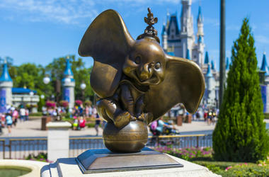 Dumbo statue at walt disney world magic kingdomorlando florida with Cinderella Princess castle