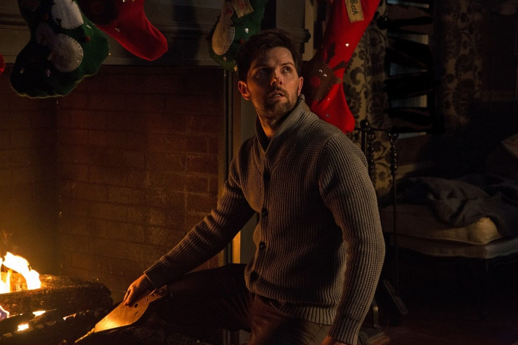 Krampus (2015) Tom (Adam Scott) stokes the fire that must keep burning.