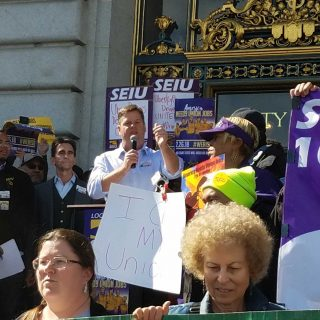 Workers rally as Supreme Court weighs union dues