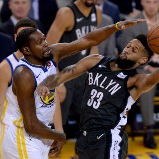 Warriors burn Nets, claim win No. 50