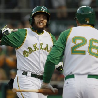 A's crush White Sox in front of massive free crowd