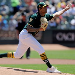A's sweep away Jays, pull into tie for Wild Card