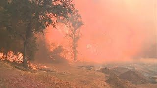 More than 13,000 firefighters battling wildfires