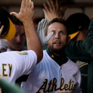 Lowrie milestone homer helps lift A's past Mariners
