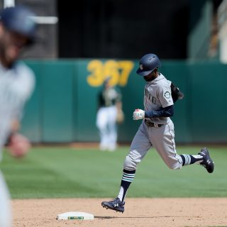 Wasted chances doom A's in 12-inning series finale loss