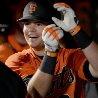 Arroyo smashes late homer, lifts Giants past Padres
